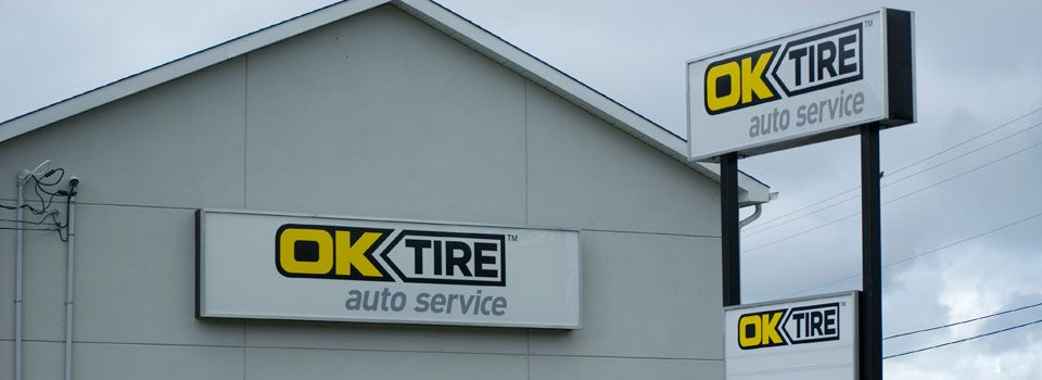 OK Tire signs and advertising